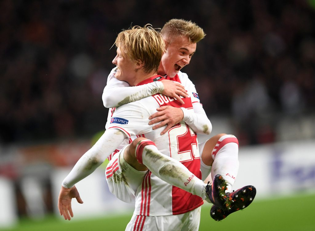 Ajax Amsterdam's Kasper Dolberg and Daley Sinkgraven celebrate a score.