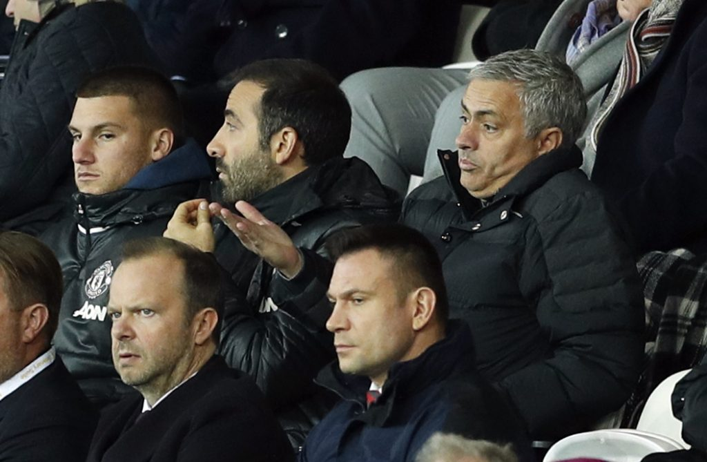 Manchester United manager Jose Mourinho looks dejected as executive vice-chairman Ed Woodward looks on.
