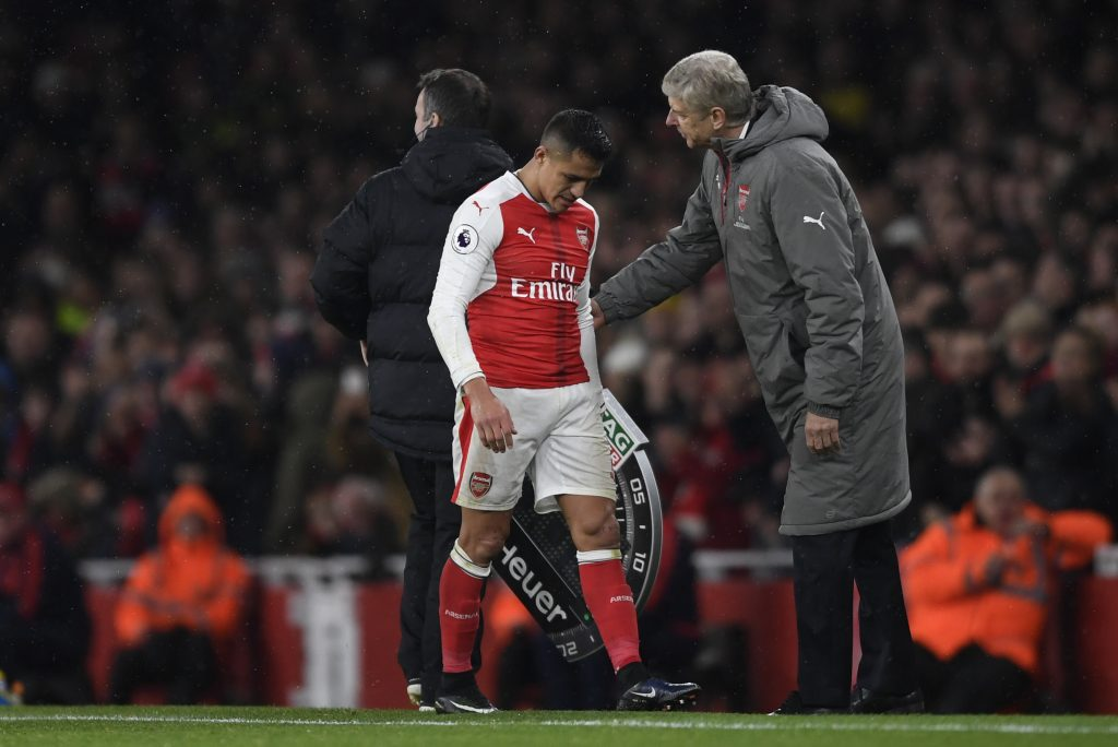Alexis Sanchez is substituted as manager Arsene Wenger looks on.