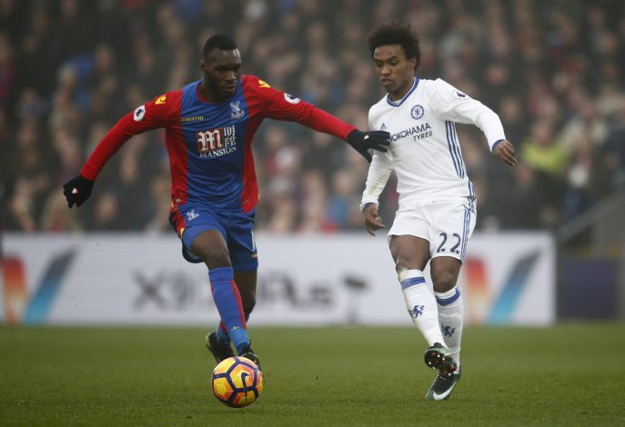 Christian Benteke in action with Chelsea's Willian.
