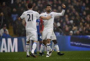 Costa celebrates scoring Chelsea's first goal with Nemanja Matic.