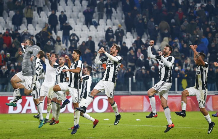 Juventus' players celebrate at the end of the match against AS Roma.