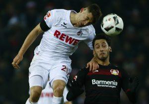 FC Cologne's Salih Oezcan (L) in action with Bayer Leverkusen's Hakan Calhanoglu.