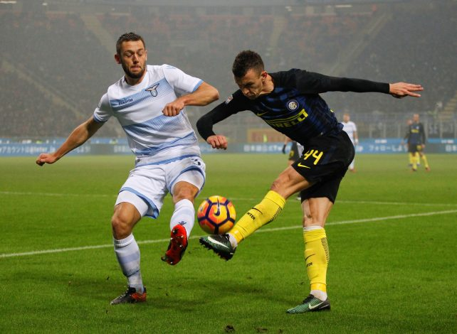 Inter Milan's Ivan Perisic (R) and Lazio's Stefan De Vrij fight for the ball.