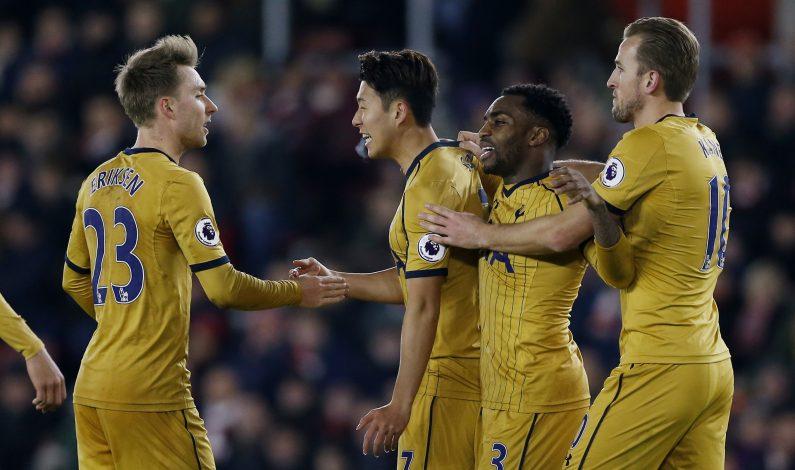 Tottenham's Son Heung-min celebrates scoring their third goal with teammates.