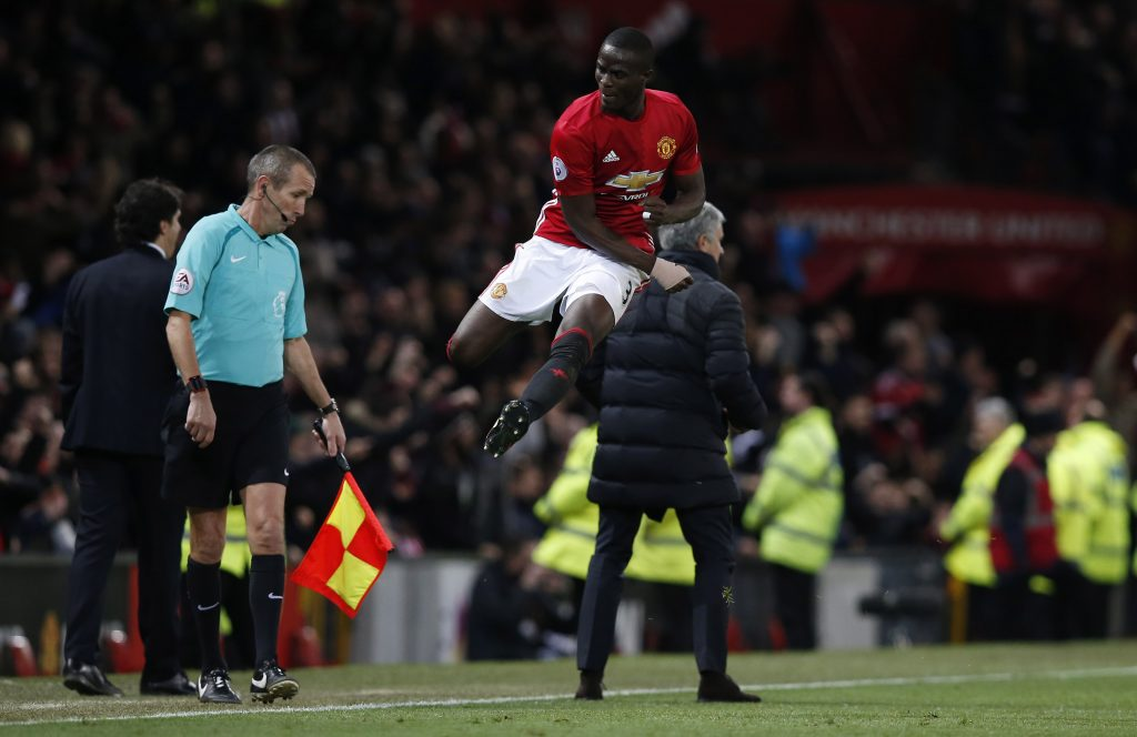 Jose Mourinho and Eric Bailly celebrate after Paul Pogba (not pictured) scores their second goal.