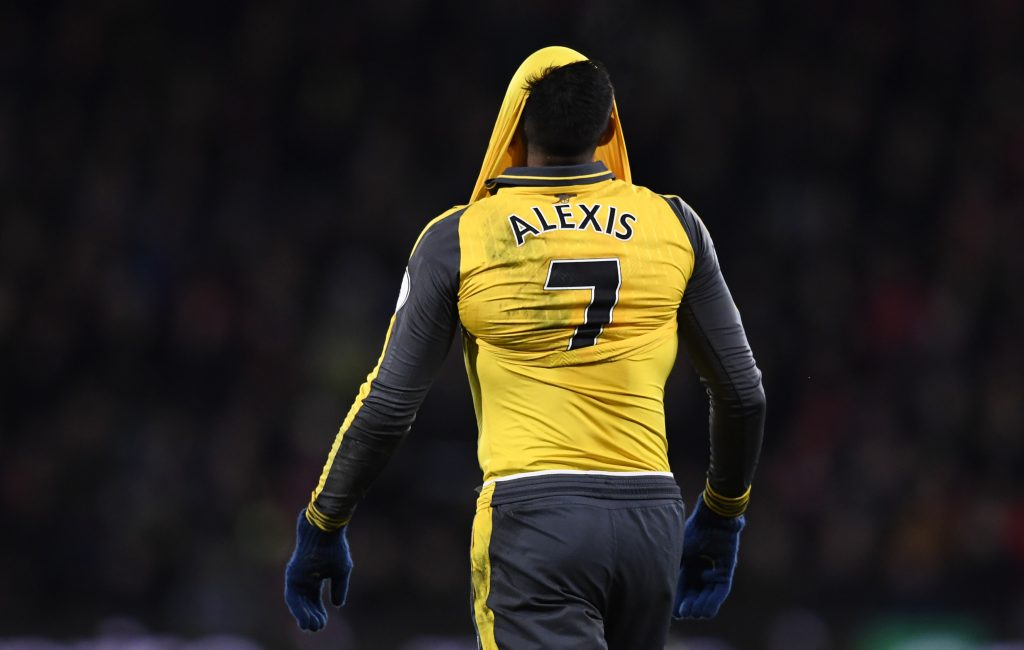 Alexis Sanchez looks dejected.