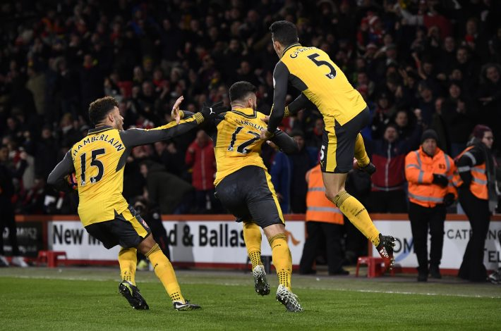 Arsenal's Olivier Giroud celebrates scoring their third goal with team mates.