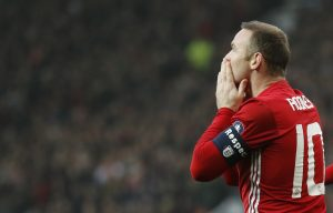 Wayne Rooney celebrates scoring.