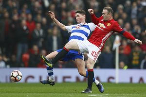 Wayne Rooney in action with Reading's George Evans.
