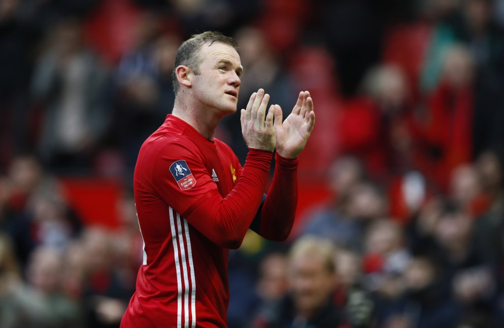 Wayne Rooney applauds fans after the game.