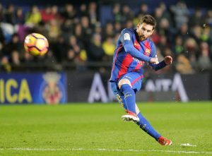 Lionel Messi shoots to score.
