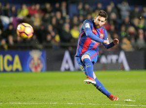 Lionel Messi shoots to score.