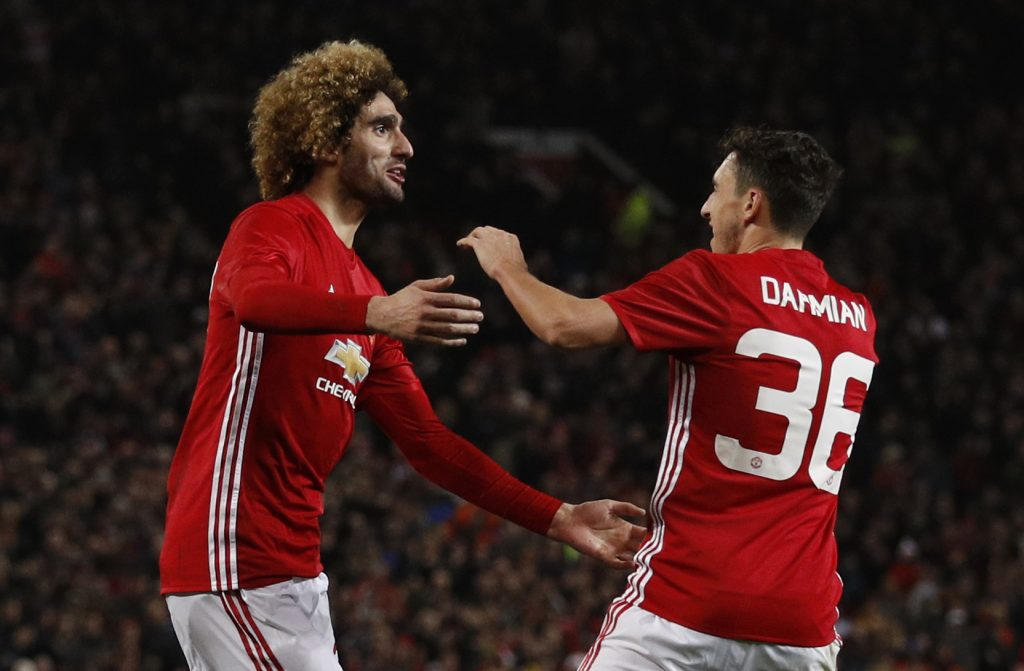 Manchester United's Marouane Fellaini celebrates scoring their second goal with Matteo Darmian.