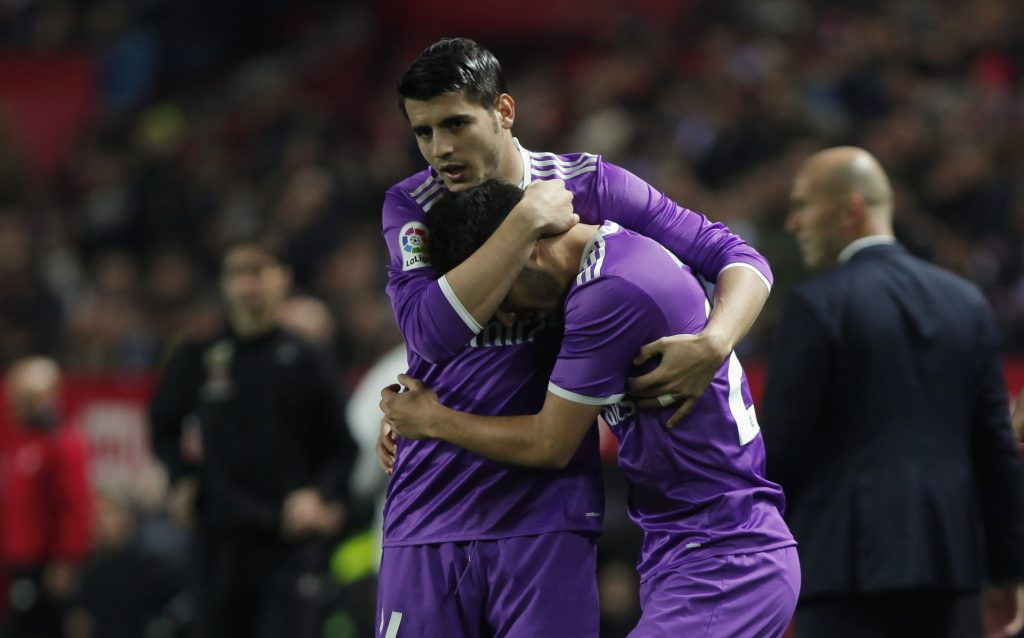 Real Madrid's Marco Asensio (R) is congratulated by team mate Alvaro Morata.