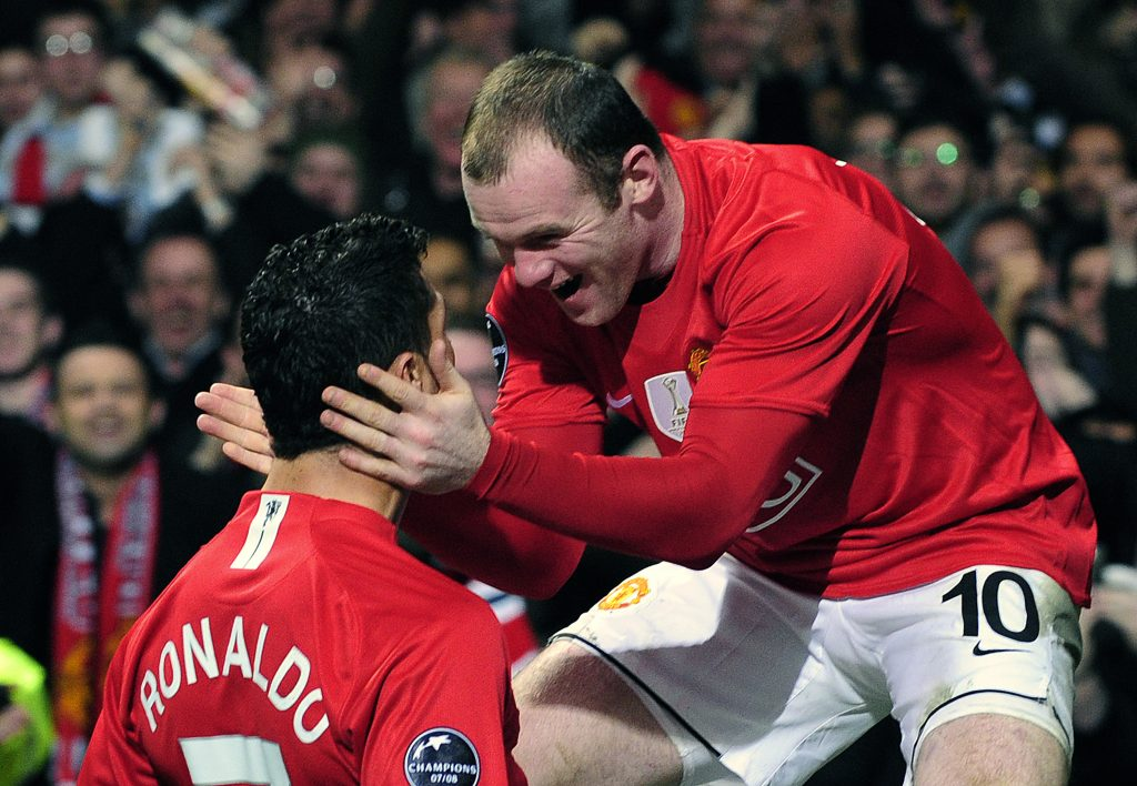 Cristiano Ronaldo (L) celebrates with Wayne Rooney after scoring during their Champions League soccer match.