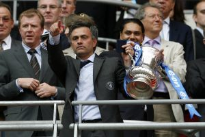 Jose Mourinho (2nd L) celebrates with the FA Cup trophy.