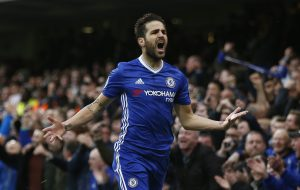Chelsea's Cesc Fabregas celebrates scoring their first goal.