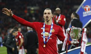 Manchester United's Zlatan Ibrahimovic celebrates with the trophy.