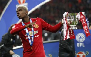 Manchester United's Paul Pogba celebrates with the trophy.