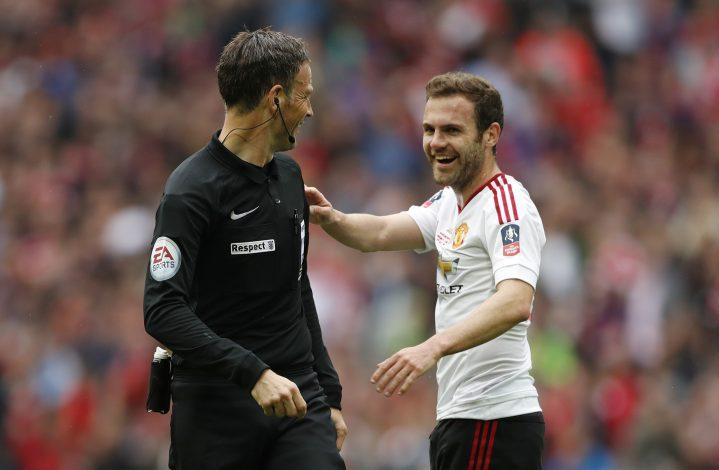 Manchester United's Juan Mata with referee Mark Clattenburg.