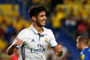 Real Madrid's Marco Asensio celebrates a goal during the match.