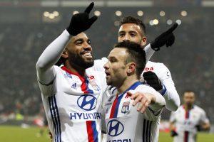Alexandre Lacazette and Mathieu Valbuena (R) celebrate after scoring for Olympique Lyon.