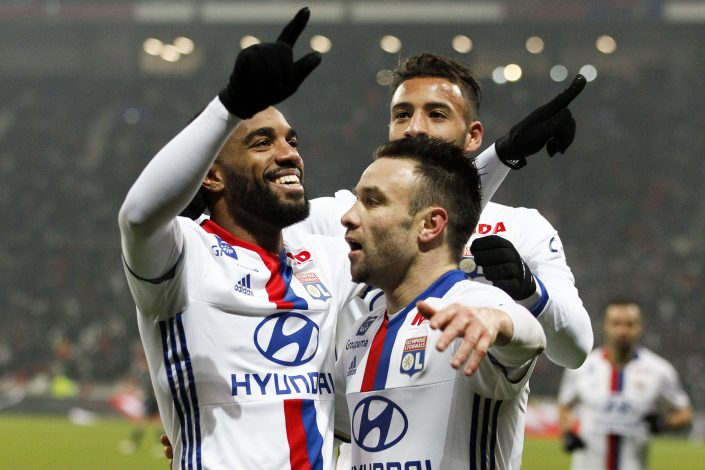 Alexandre Lacazette and Mathieu Valbuena (R) celebrate after scoring for Olympique Lyon.