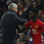 Manchester United's Axel Tuanzebe with manager Jose Mourinho.