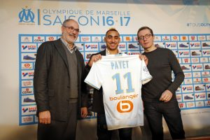 Olympique Marseille's latest recruit Dimitri Payet (C) displays his new jersey.