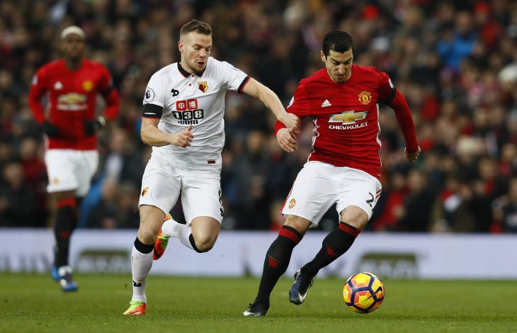 Manchester United's Henrikh Mkhitaryan in action with Watford's Tom Cleverley.