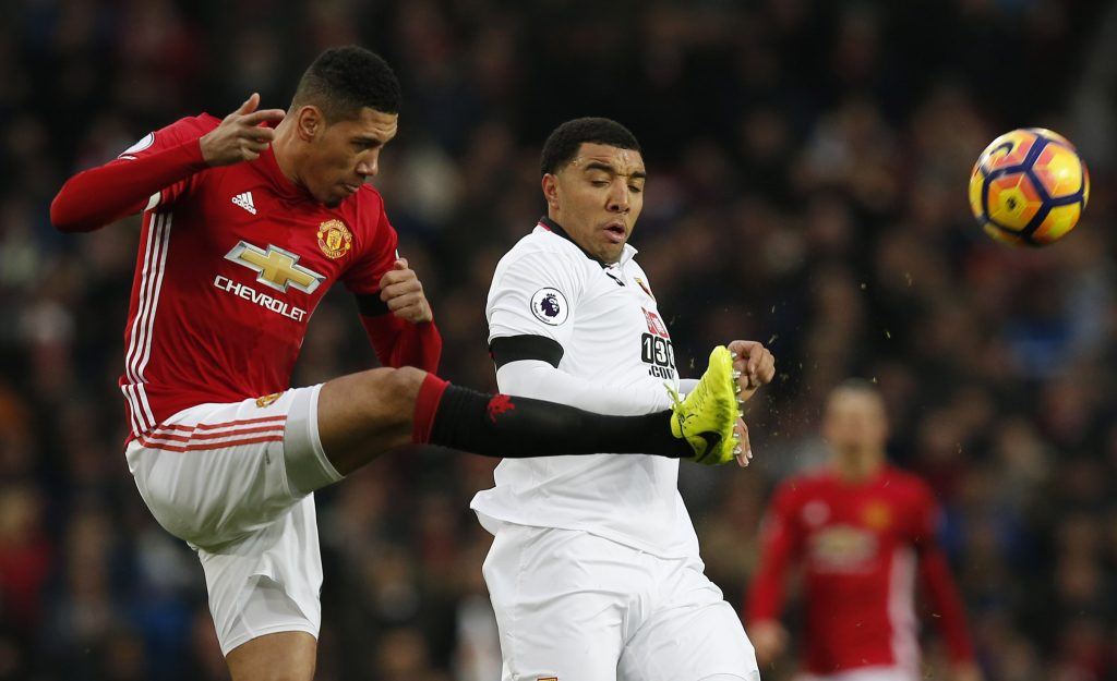 Manchester United's Chris Smalling in action with Watford's Troy Deeney.