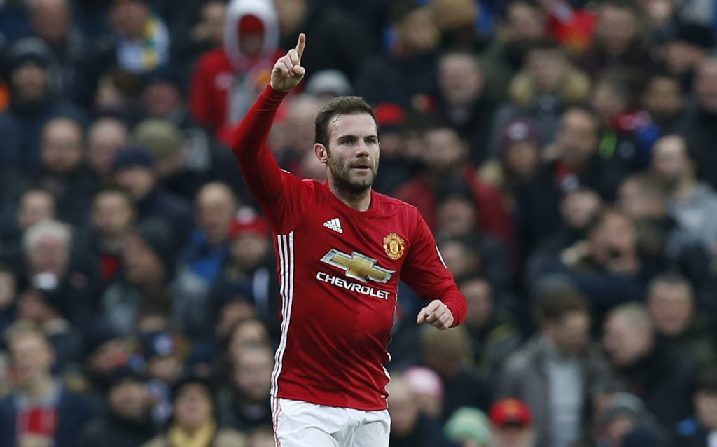 Juan Mata celebrates scoring their first goal.