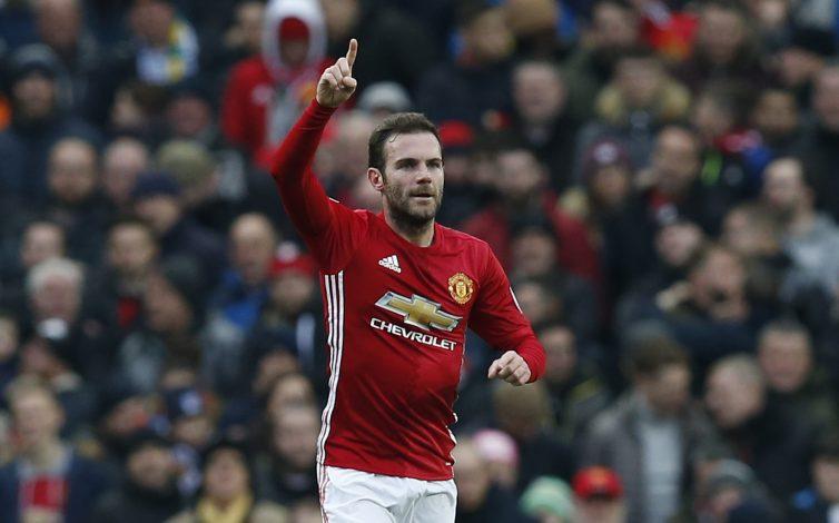 Juan Mata celebrates scoring their first goal.