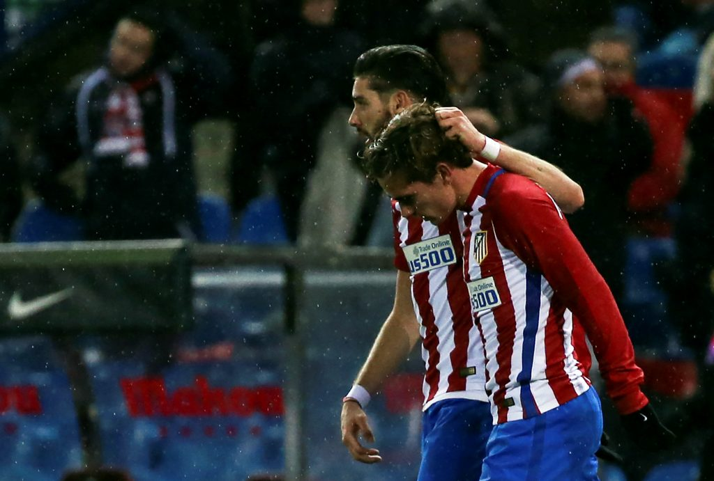 Atletico Madrid's Antoine Griezmann (R) is congratulated by teammate Yannick Ferreira-Carrasco.