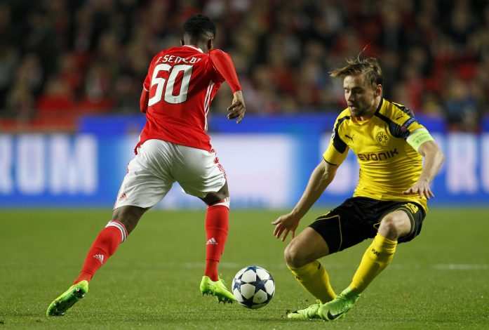 Benfica's Nelson Semedo in action with Borrusia Dortmund's Marcel Schmelzer.