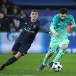 Barcelona's Lionel Messi in action with Paris Saint-Germain's Marco Verratti.