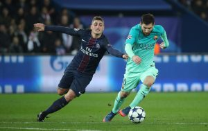 Barcelona's Lionel Messi in action with Paris Saint-Germain's Marco Verratti.
