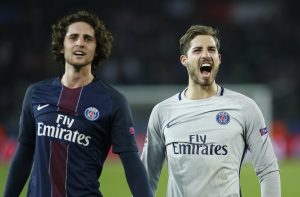 Paris Saint-Germain's Adrien Rabiot and Kevin Trapp celebrate after the game.