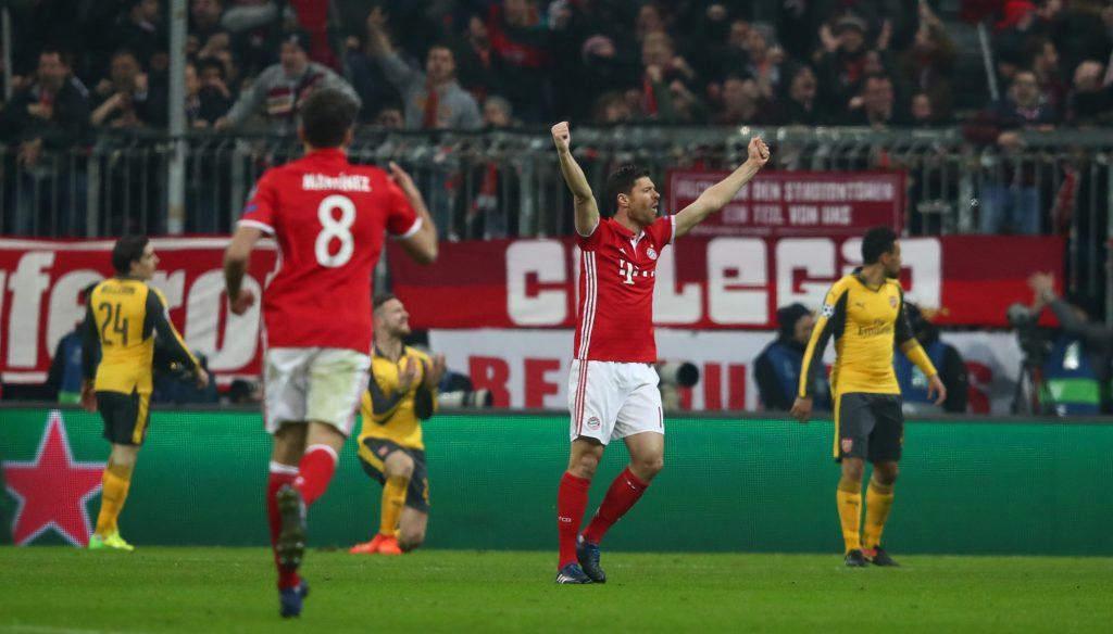 Bayern Munich's Xabi Alonso celebrates after Robert Lewandowski scores their second goal.