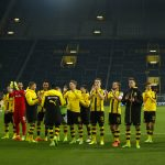 Borussia Dortmund players react after their match v VFL Wolfsburg in front of the empty southern stands due to a one-match ban for Dortmund fans.