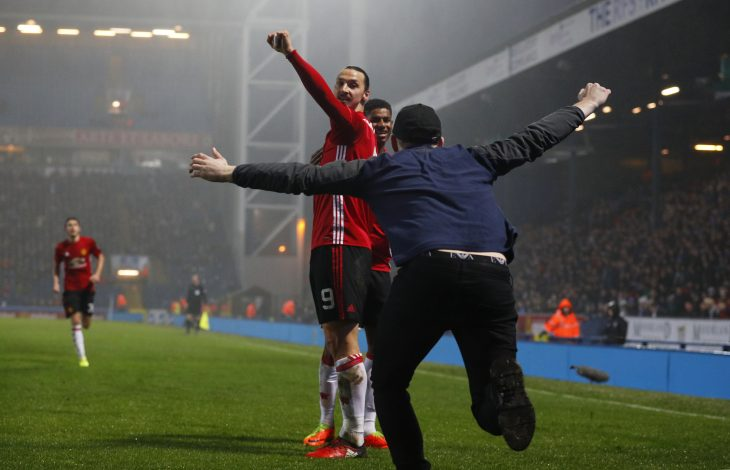 Manchester United's Zlatan Ibrahimovic celebrates scoring their second goal with team mates and fans.
