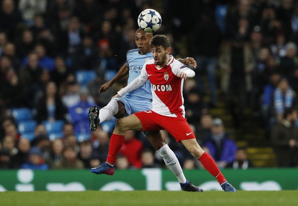 Manchester City's Fernandinho in action with Monaco's Bernardo Silva.