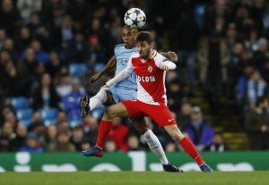 Manchester City's Fernandinho in action with Monaco's Bernardo Silva.
