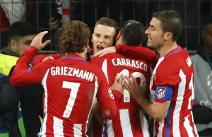 Kevin Gameiro celebrates scoring from the penalty spot with Yannick Carrasco and Antoine Griezmann.
