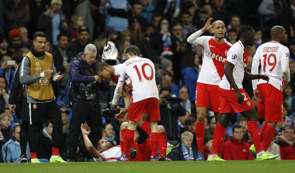 Monaco's Radamel Falcao celebrates scoring their third goal with team mates.