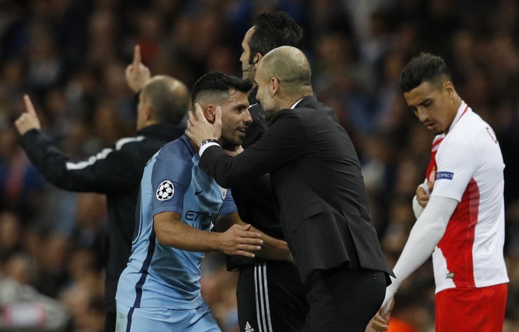 Sergio Aguero with Manchester City manager Pep Guardiola after being substituted.