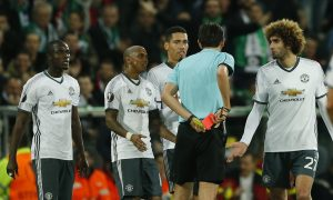 Manchester United's Eric Bailly is sent off by referee.