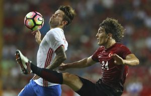 Turkey's Caglar Soyuncu (R) and Russia's Fedor Smolov in action.