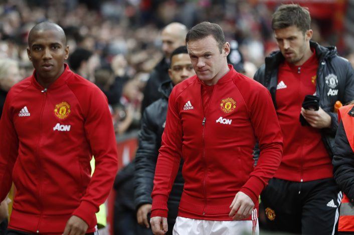 (L - R) Manchester United's Ashley Young, Wayne Rooney and Michael Carrick.